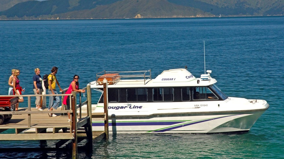 Travellers get ready to board a Cougar Line vessel in the Marlborough Sounds