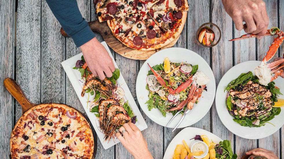 A selection of stone-baked pizza, local seafood and other dishes at Punga Cove in the Marlborough Sounds, New Zealand.