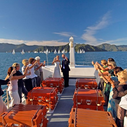 A newly married couple celebrate their wedding in the Marlborough Sounds aboard a Cougar Line boat.