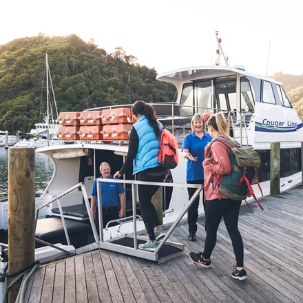 Cougar Line passengers board their boat in Picton Marina in the Marlborough Sounds, New Zealand.